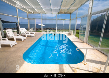 Covered swimming pool and jacuzzi in Casapueblo Punta del Este Uruguay with a great view to the ocean - Stock Photo