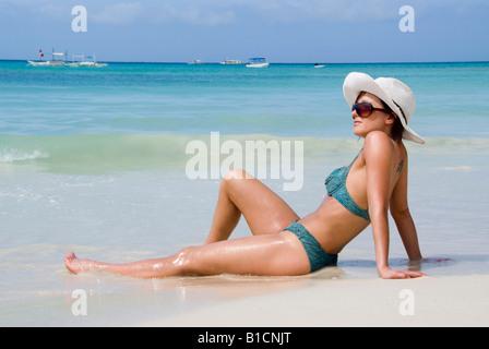 young woman in bikini on the beach - Stock Photo