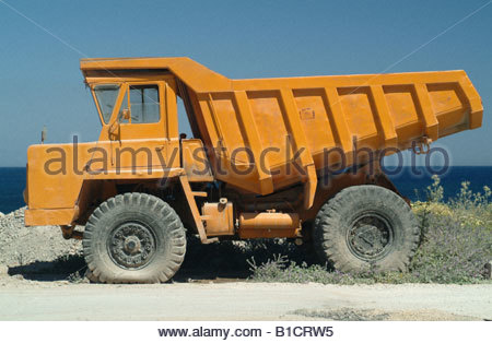 Large heavy duty yellow tipper lorry vehicle truck trucks Orange lorry dump truck dumper Construction nice photo - Stock Photo