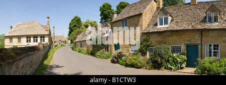 Snowshill Manor and stone cottages in the Cotswolds village of Snowshill, Gloucestershire - Stock Photo