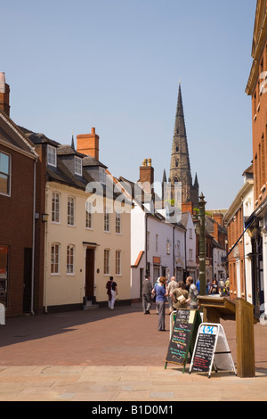 View along pedestrianised narrow street with historic buildings to cathedral spire. Dam Street Lichfield Staffordshire - Stock Photo