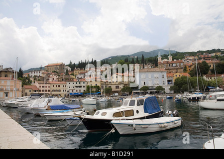 Volosko Istria Croatia Europe May Looking over the moored boats in the harbour of this small fishing village - Stock Photo