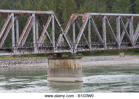 A close-up on the mid-river concrete support of a railroad bridge over the Pend Oreille River, North Idaho. - Stock Photo