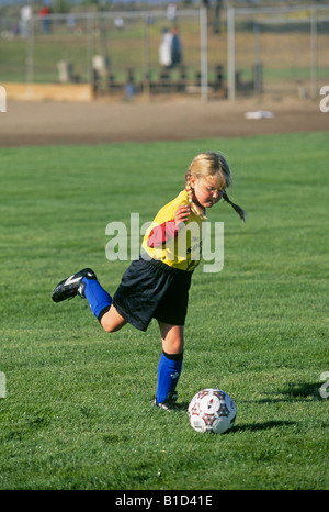 A first grade girl plays girl s fall soccer with a local Parks Recreation Department in Redmond Oregon - Stock Photo
