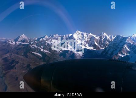 Kings of the Himalaya mountain range, Nuptse, Mount Everest and Lhotse, seen from a plane - Stock Photo