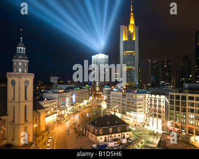 skyline of Frankfurt in the night view over Hauptwache main guard to west beams of light and colourful lightened - Stock Photo