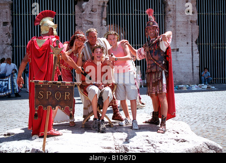 tourists posing with costumed roman legionaries being. Black Bedroom Furniture Sets. Home Design Ideas