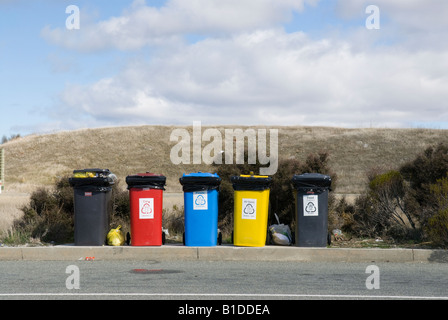 Coloured recycling bins for sorting waste - Stock Photo