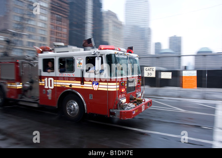 An FDNY truck races to the scene of an emergency near the World Trade Center site in Manhattan, NY