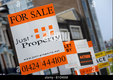 Hastings estate agent for sale boards jostle for best position on a residential street. picture by Jim Holden. - Stock Photo