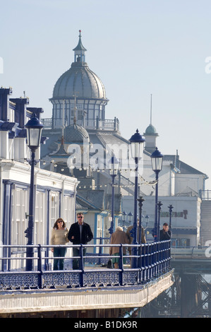 Eastbourne Pier bathed in sunshine as visitors stroll the decking. Picture by Jim Holden. - Stock Photo