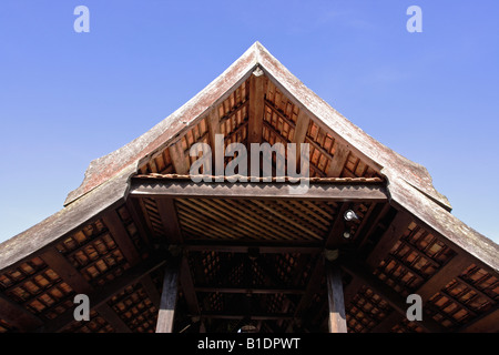 Beautiful gable of a traditional Malay house in Terengganu, Malaysia. The roof is made of baked clay tile. - Stock Photo