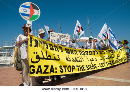 Leftists activists holding Israeli a Palestinian flags demonstrate against continue siege of Gaza strip by Israel - Stock Photo
