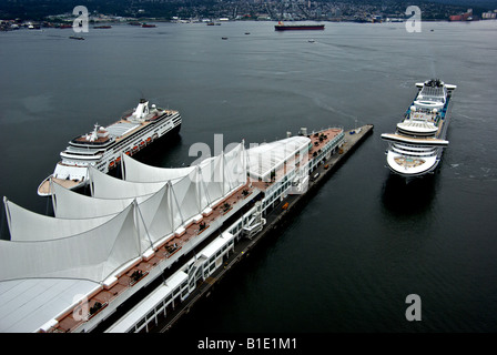 Aerial view of two cruise ships in Vancouver Harbour coming into dock at Canada Place cruise terminal - Stock Photo