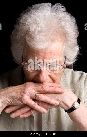 An old woman looking worried, UK. - Stock Photo