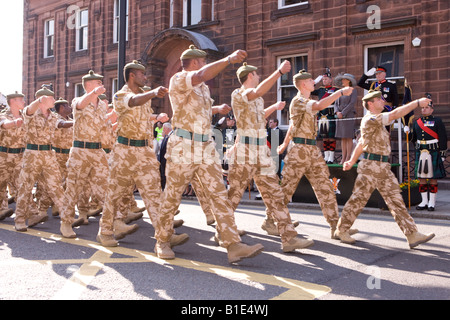 The Royal Regiment of Scotland soldiers marching through Dumfries town centre in desert fatigues after return from - Stock Photo