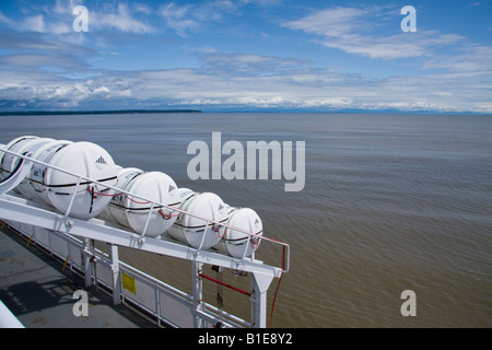 Inflatable liferafts in hard-shelled canister on a passenger ferry - Stock Photo