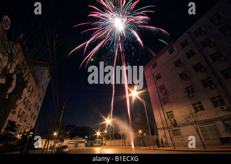 China Beijing Chinese New Year Spring Festival fireworks being let off in the street - Stock Photo