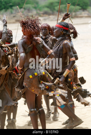 Hamar women dance during a 'Jumping of the Bull' ceremony. The Hamar are semi-nomadic pastoralists of Southwest - Stock Photo