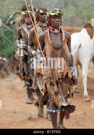 A group of Hamar women dance at a 'Jumping of the Bull' ceremony. The Hamar are semi-nomadic pastoralists of Southwest - Stock Photo
