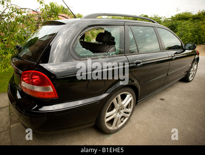 Smashed rear car window - Stock Photo
