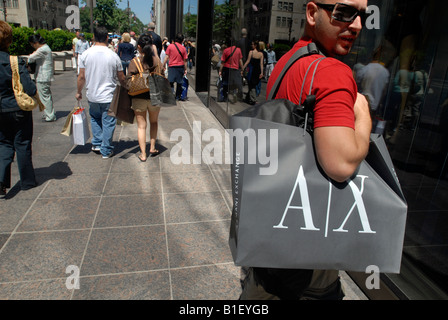 Shoppers on Fifth Avenue in New York - Stock Photo