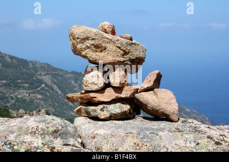Cairn of rocks in the Calanques de Piana, Corsica, France - Stock Photo