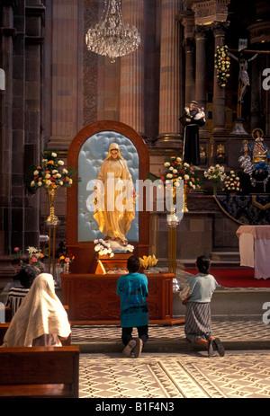 Mexican people, praying, altar, San Francisco Church, San Miguel de Allende, Guanajuato State, Mexico - Stock Photo