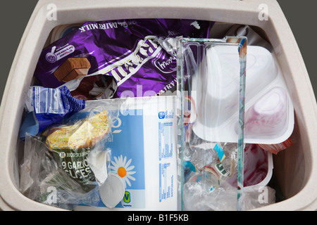 Single-use plastic household rubbish thrown out in waste bin from above. England UK Britain - Stock Photo