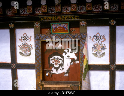 Bhutan Bumthang Valley Jakar main street painting on shop front - Stock Photo