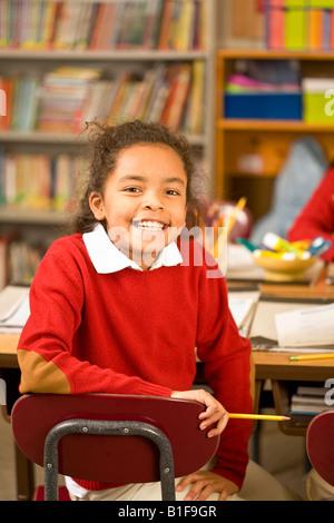 African girl sitting in school desk - Stock Photo
