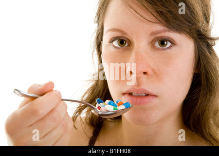 young brunet girl with diverse tablets - Stock Photo