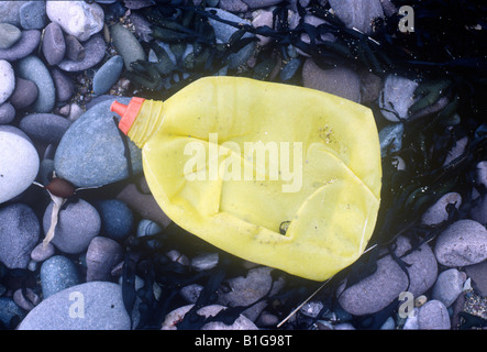 plastic bottle on beach Pembrokeshire - Stock Photo