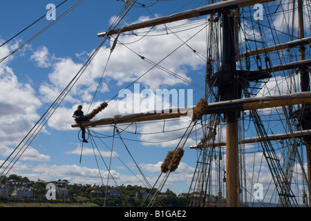 Young sailor on the rigging of the sailing ship Kaskelot while berthed at Bangor Northern Ireland 14 June 2008 - Stock Photo