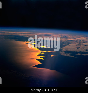The Earth from Space Sunrise on the Mozambique Channel along the coast of Madagascar - Stock Photo
