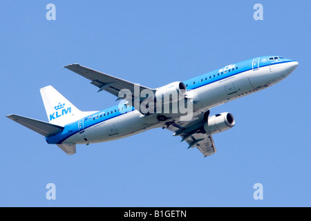 Boeing 737 operated by KLM climbing out from London Heathrow Airport - Stock Photo