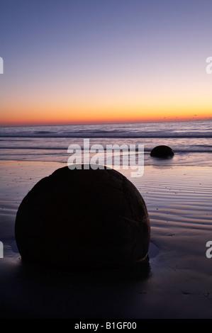 Sunrise Moeraki Boulders North Otago South Island New Zealand - Stock Photo