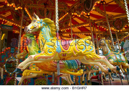 Galloping Horse carousel or Roundabout, fairground ride, in the Old Market Square Nottingham, England - Stock Photo