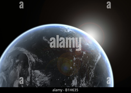 Sun emerging over planet earth - Stock Photo
