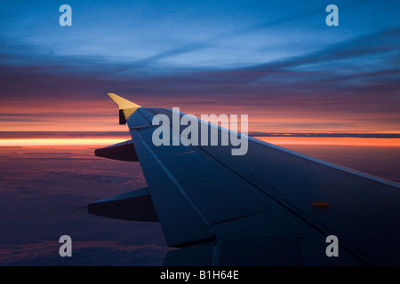 Airplane wing at sunset - Stock Photo