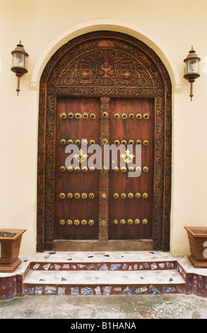 Doorway with detail of brass-studded and carving in Stonetown Zanzibar, Tanzania, East Africa. - Stock Photo