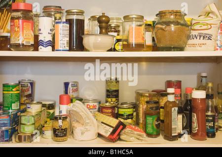 Kitchen food storage cupboard - Stock Photo
