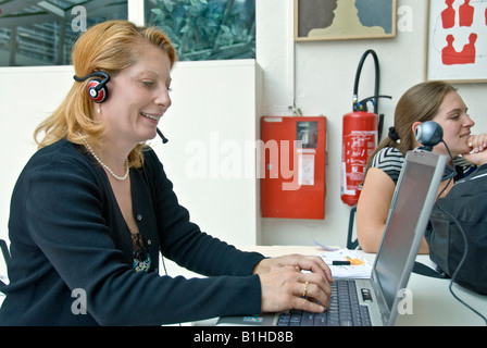 Paris FRANCE Woman Talking, Looking at Computer Screen, Laptop Internet Telephone with Web cam in WIFI Internet - Stock Photo