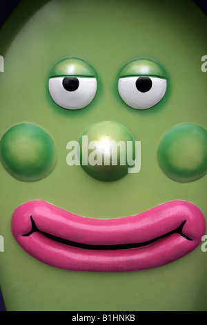 GREEN EGG SHAPED CARTOON CHARACTER WITH PINK LIPS AND GREEN CHEEKS AND NOSE VERTICAL BDB10061 - Stock Photo