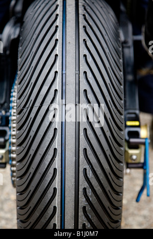 Close-up of a rear wet weather tyre on a racing motorcycle, Thrxton, Hampshire, England. - Stock Photo