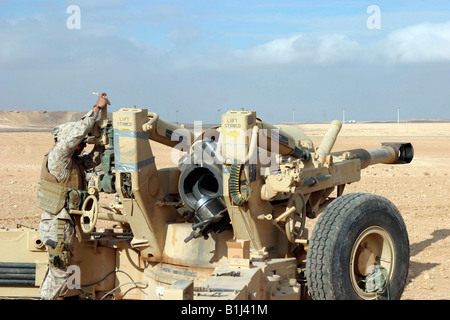 U.S. Marines with Lima Battery, 2nd Battalion, 13th Marine Regiment prepare to fire a howitzer near Baghdad, Iraq - Stock Photo
