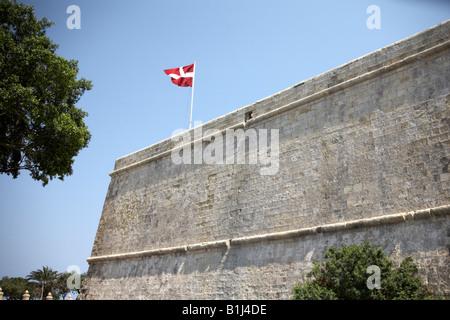 St John Bastion with Maltese flag flying above in Valetta or Valletta Malta - Stock Photo
