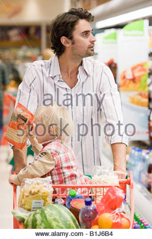Father and child in supermarket - Stock Photo