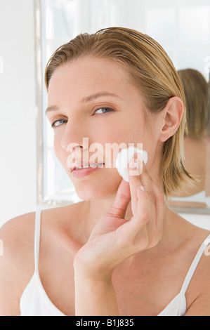 A woman applying make up - Stock Photo