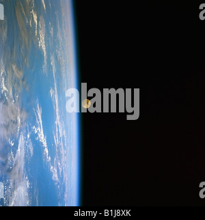 Moonrise over the Earth View from Space - Stock Photo